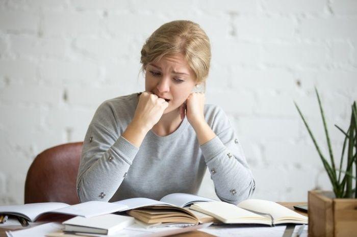 Ilustrasi seorang wanita yang tengah stres.